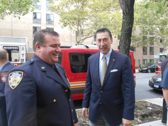 Commisioner Nigro with NYPD Detective William O'Connor, Jr., the son of one of the fallen firefighters.  (Photo by Mike T. Wright)