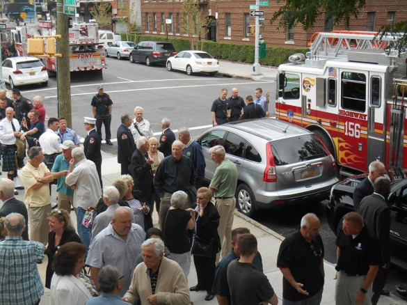 Attendees gather in front of the church after the service. (Photo by Mike T. Wright)